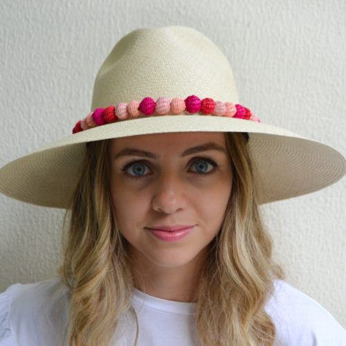 Hat with red and pink pompoms