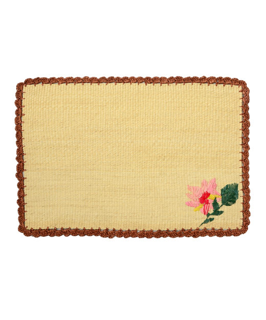 Straw placemat with handwoven flower