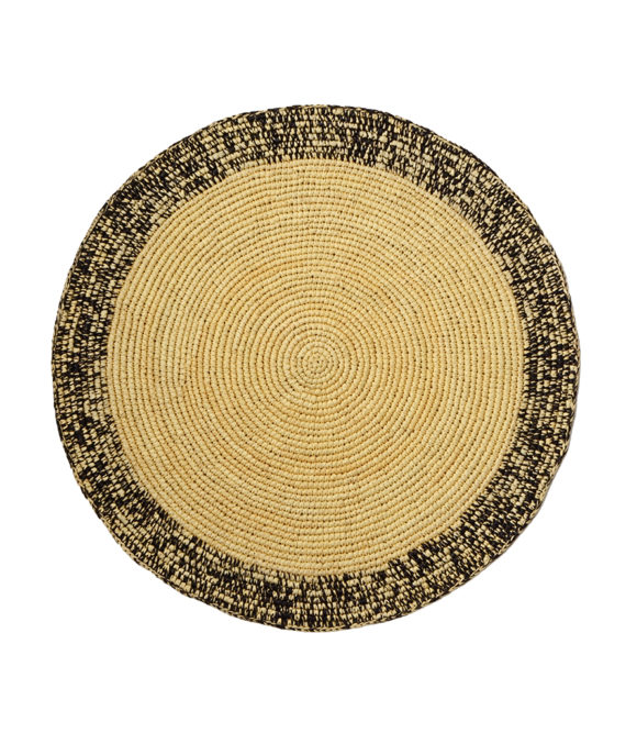 Straw placemat with black speckles