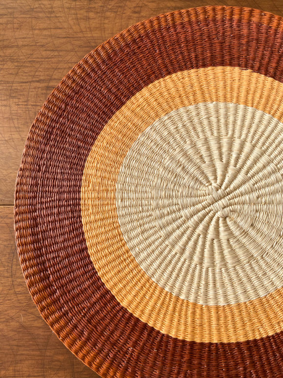 Straw placemat with stripes