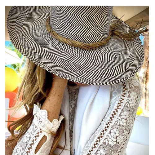 Elle MacPherson with Wide brim sun hat with olive trim