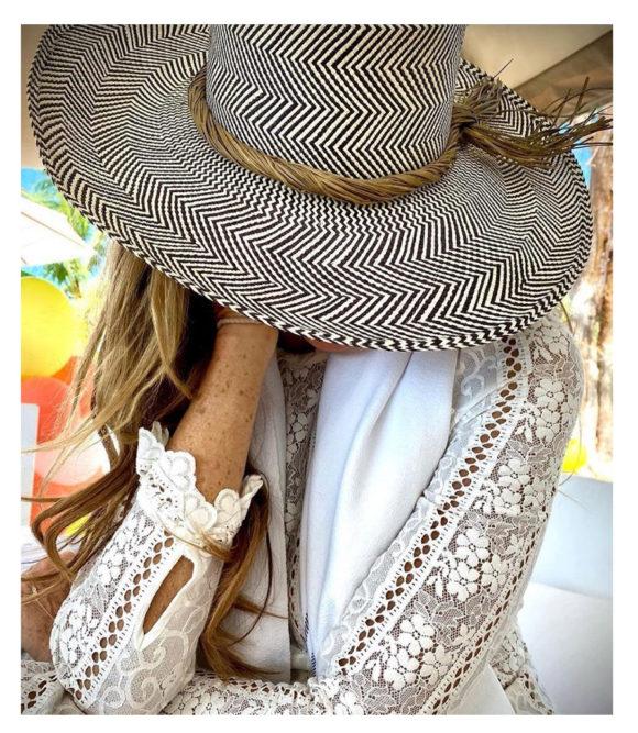 Elle MacPherson with Wide brim sun hat with olive trim